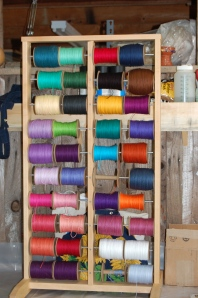 Think of the friendship bracelet possiblities! Spools and spools of beautiful yarn - delicious!